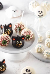 Halloween gourmet cake pops with light background. Autumn concept. Halloween holiday.