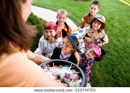 Halloween: Group Of Kids Want Halloween Candy
