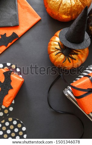 Halloween holiday background with pumpkins, spiders, bats, gifts. Creative festive flat lay. stock photo