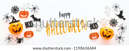 Halloween holiday concept over white wooden background. Top view, flat lay banner - Shutterstock ID 1198636684