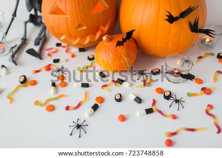 halloween, holidays and decoration concept - jack-o-lantern or carved pumpkins with candles on white background #723748858