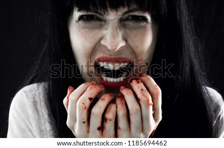 Halloween horror. Crazy bloody scary zombie woman