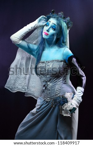 Halloween: Horror scene of a corpse bride under blue moon light