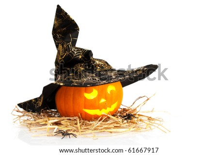 stock photo : Halloween jack o lantern carved pumpkin wearing witches hat on straw with spiders and white background