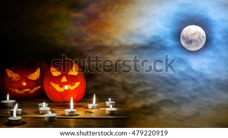 Halloween jack-o-lantern on the terrifying  midnight sky with full moon background. Halloween symbol smiling pumpkin background.  #479220919