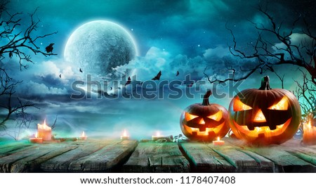 Halloween - Jack O' Lanterns And Candles On Table In Misty Night  #1178407408