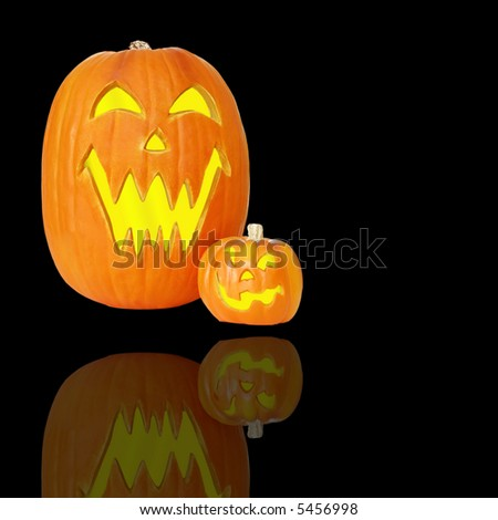 Halloween Jack O Lanterns - Carved and lit jack o lantern pumpkins with space for copy.