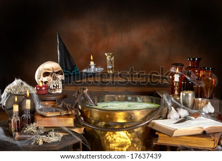 Halloween kitchen of a witch, with a cauldron full of poison soup, with copy space