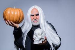 Halloween makeup. Horror. Halloween decoration. Scary concept. 31 october. Halloween man with pumpkin in skull. Devil man on Halloween pumpkin. Devil.