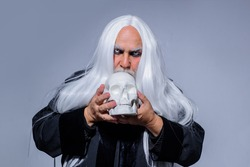 Halloween makeup. Horror. Halloween decoration. Scary concept. 31 october. Halloween man with skull. Devil man. Autumn concept.