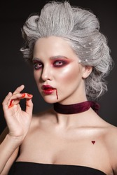 Halloween makeup style. Blood queen. Bride of Dracula image.