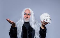 Halloween man with skull. Devil man. Halloween makeup. Horror. Halloween decoration. Scary concept. 31 october. Autumn concept.