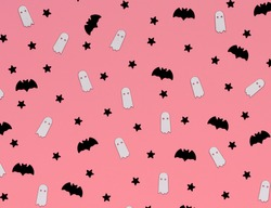 Halloween minimal pattern with ghost and bat, pink background