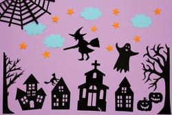 halloween night scene. Halloween background with pumpkin, witch, stars, clouds. Handmade paper decoration for Halloween.