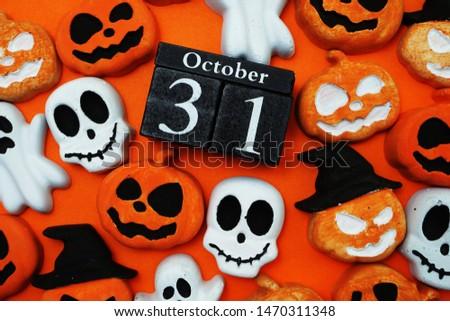 Halloween 31 october with pumpkin decorate on orange background
