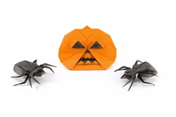 Halloween Origami Pumpkin Jack-o-lantern with black origami spiders