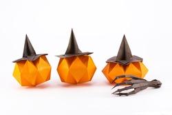 Halloween Origami Pumpkin Jack-o-lantern with cut-off origami hand skeleton