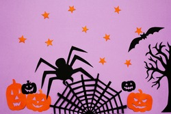 Halloween paper decoration with pumpkin, spider, web. Greeting card, autumn season concept. Top view, flat styling. Happy halloween.
