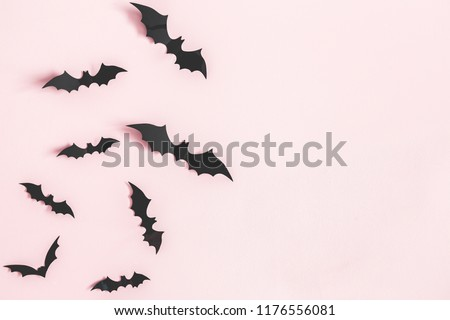 Halloween paper decorations on pastel pink background. Halloween concept. Flat lay, top view, copy space stock photo