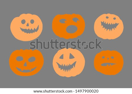 Halloween paper decorations - various scary pumpkin faces. Composites on grey background