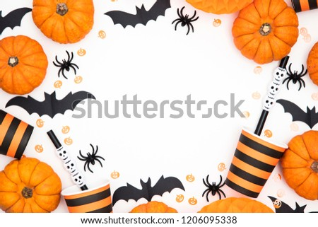Halloween party background with pumpkins, spooky bats, creepy spiders #1206095338