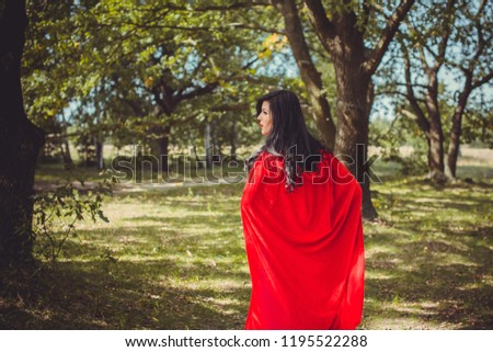 Halloween party concept, mysterious girl in black lace handmade dress and red hood. Beautiful young woman. Inspiration for halloween celebration, ideas and simple nice detail #1195522288