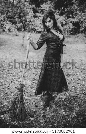 Halloween party concept, mysterious girl in black lace handmade dress. Beautiful young dark witch woman. Inspiration for halloween celebration, ideas and simple nice detail  #1193082901