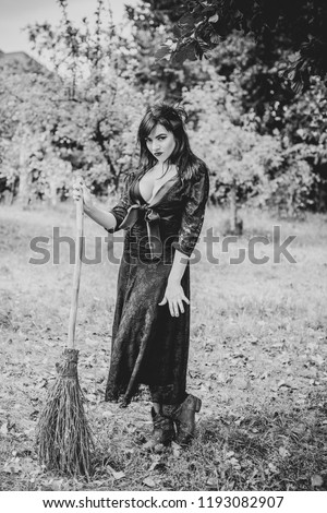 Halloween party concept, mysterious girl in black lace handmade dress. Beautiful young dark witch woman. Inspiration for halloween celebration, ideas and simple nice detail  #1193082907