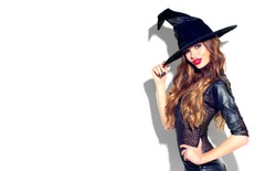 Halloween Party girl. Happy Halloween Witch with bright make-up and long hair. Beautiful young surprised woman posing in witches sexy costume. Isolated on white background