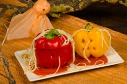 Halloween party meal for kids, fake pumpkins with pasta worms
