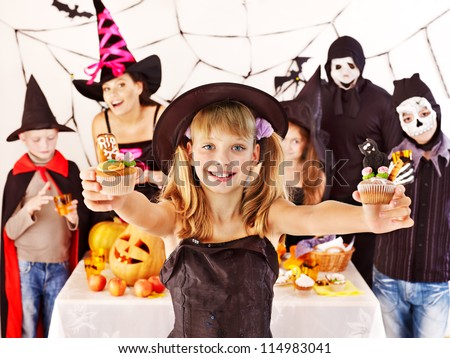 Halloween party with group children holding trick or treat.