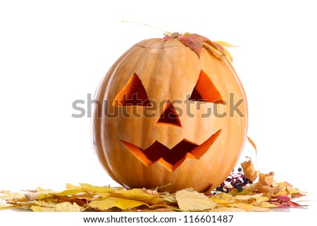 halloween pumpkin and autumn leaves, isolated on white