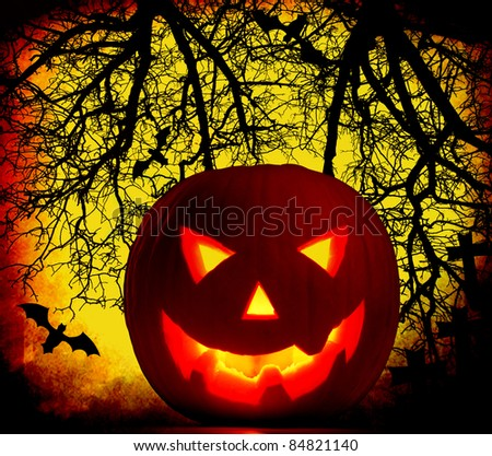 Halloween pumpkin background with glowing jack-o-lantern at night, cemetery in the dark forest - stock photo