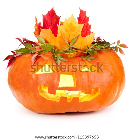 Halloween pumpkin crowned with autumn leaves