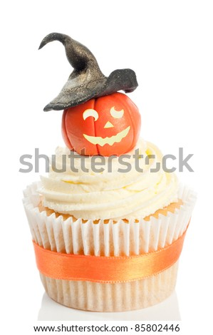 Halloween pumpkin cupcake wearing a witches hat on white background
