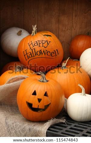Halloween pumpkin display. Shallow depth of field, focus on the front pumpkin.