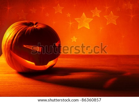 Halloween pumpkin glowing candle, warm autumn holiday background, traditional jack-o-lantern, night party decoration