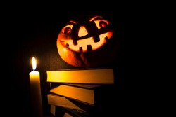Halloween.  pumpkin head and books