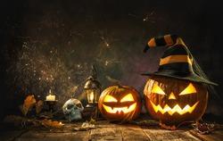 Halloween pumpkin head jack lantern with burning candles