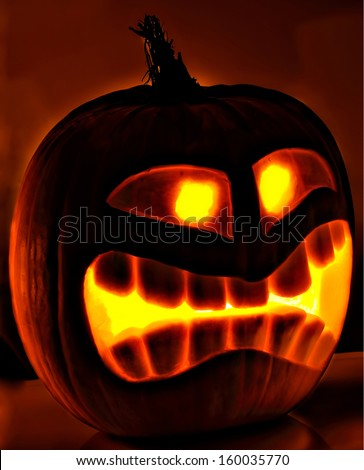 Halloween pumpkin head jack lantern with scary evil faces