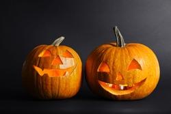 Halloween pumpkin head jack lanterns on dark background