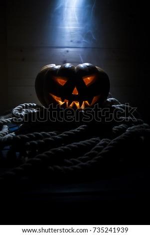 Halloween pumpkin head. Scary evil face spooky holiday. Helloween part. Helloween attributes.
