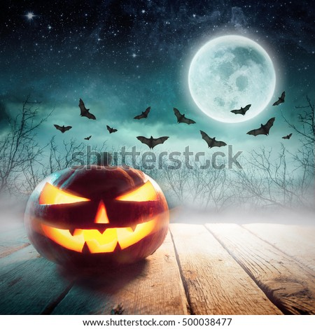 Halloween Pumpkin in a dark mist Forest. Studio shot. Elements of this image furnished by NASA #500038477