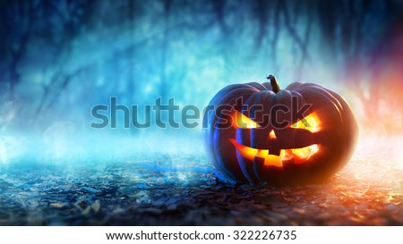 Halloween Pumpkin In A Mystic Forest At Night  #322226735