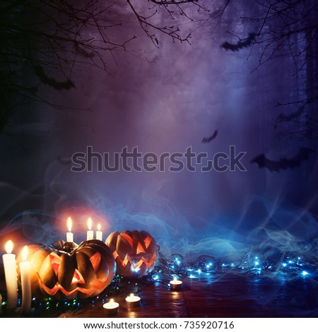 Halloween Pumpkin In A Mystic Forest At Night #735920716