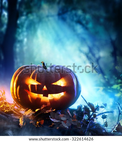 Halloween Pumpkin In A Spooky Forest At Night - Scary Scene  #322614626