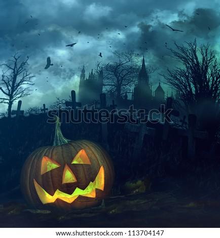 Halloween pumpkin in a spooky graveyard
