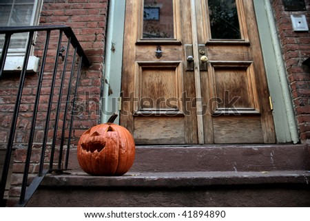 halloween pumpkin in front of a door