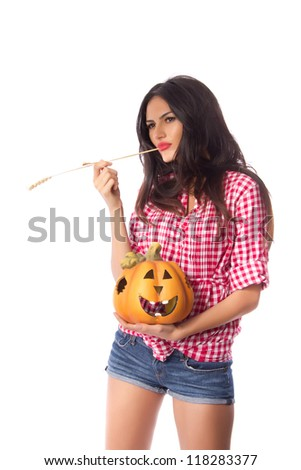 Halloween pumpkin in good hands - Beautiful young woman with a dreamy look holding a smiling Halloween pumpkin on white background