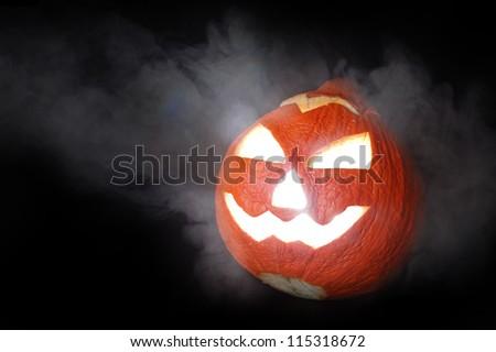 halloween pumpkin jack-o-lantern on black background